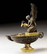 A gilt-bronze and bronze oil lamp, first quarter 19th century